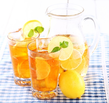 Close up of fresh and cold ice tea with sliced lemon and mint Stock Photo - 16819688