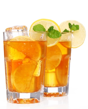 Fresh and cold ice tea with sliced lemon and mint photo
