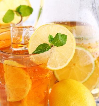 ice water: Close up of fresh and cold ice tea with sliced lemon and mint