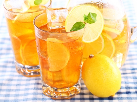 Close up of fresh and cold ice tea with sliced lemon and mint photo