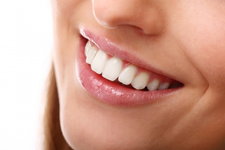 teeth white: Beautiful smile close up with perfectly white teeth Stock Photo
