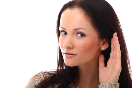 Portrait of beautiful young woman listening gesture photo