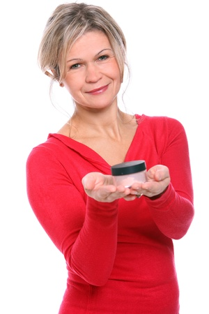Beautiful mid aged blonde with jar of cream in hands Stock Photo