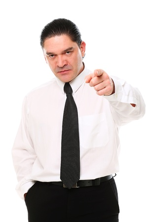 Serious mid aged businessman pointing on you over a white background photo