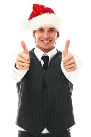 cappello natale: Felice l'uomo in tuta ufficio con il cappello di natale in studio