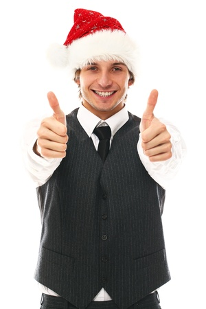 santa suit: Happy man in office suit with christmas hat in studio Stock Photo