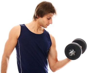 Handsome and sporty guy lifting dumbbell over a white background Stock Photo - 16833008