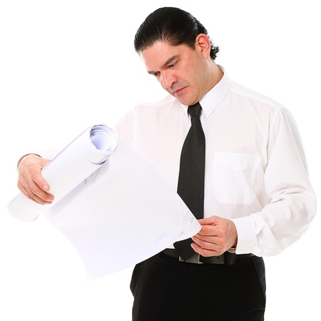 Mid aged architect holding building plans over a white background photo