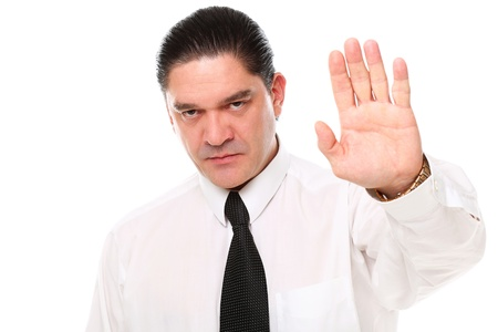Serious mid aged businessman showing stop gesture over a white background Stock Photo - 16832953