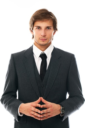Confident and handsome man in suit portrait over a white background photo