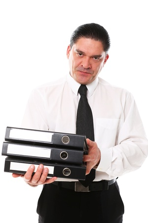 Mid aged office worker holding folders over a white background Stock Photo - 16833450
