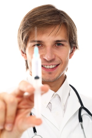 assistent: Young and handsome doctor holding syringe over a white background