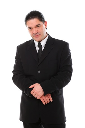 Confident mid aged man in suit posing in studio over a white background Stock Photo - 16832867
