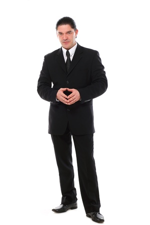 Confident mid aged man in suit posing in studio over a white background Stock Photo - 16832699