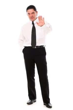 Serious mid aged businessman showing stop gesture over a white background photo