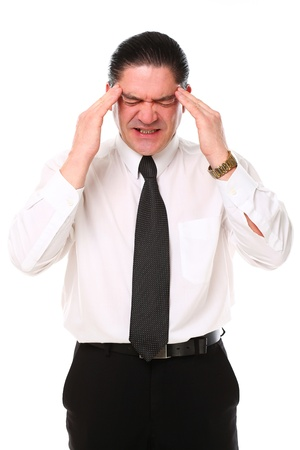 Mid aged businessman have a migraine over a white background photo