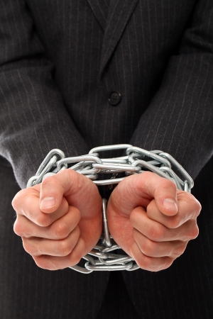 fettered: Close up of businessman hands chained over a white background Stock Photo