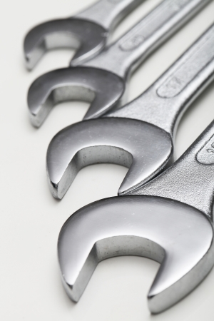auto service: Closeup of iron spanners set over a white background