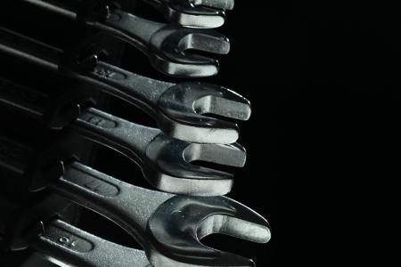 Closeup of iron spanners set over dark light in studio Stock Photo - 16913671