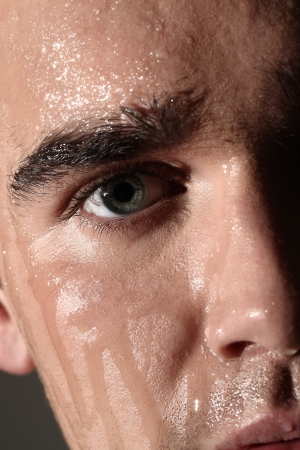 caucasian water drops: Face portrait of wet and handsome man in studio