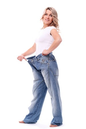 losing loss: Happy mid aged woman in big pants after weight losing
