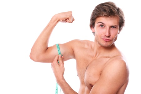 a man measuring his muscle over a white background Stock Photo - 16934765
