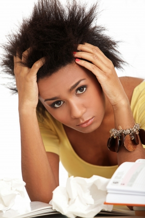 Young black woman tired from studying with books Stock Photo - 16999140