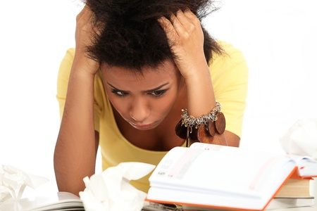 Young black woman tired from studying with books Stock Photo - 16997804