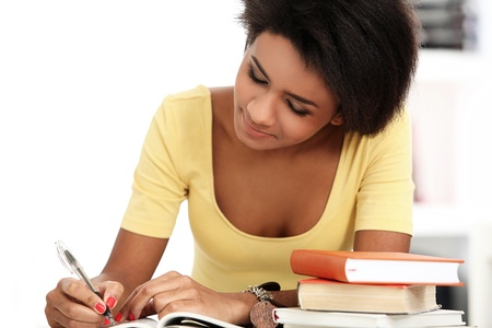 Young and beautiful afro woman studying with books Stock Photo - 16998474