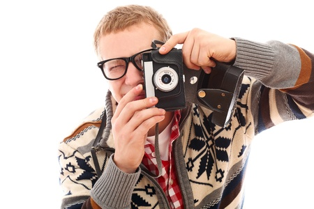 Young photographer with old camera make a photo shoot of you isolated on a white photo