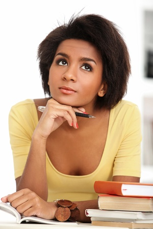 Young and beautiful afro woman studying with books Stock Photo - 16998940