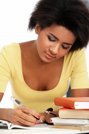 Young and beautiful afro woman studying with books Stock Photo - 16999148
