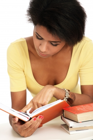 Young and beautiful afro woman studying with books Stock Photo - 16999065