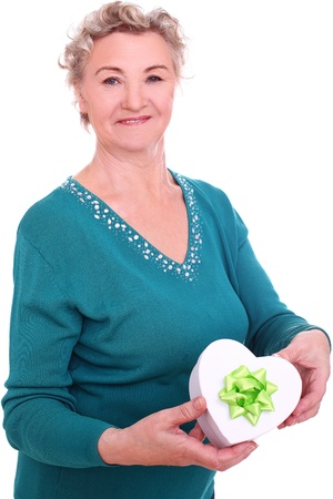 congenial: Smiling granny with gift in hand over a white background