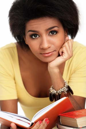 Young and beautiful afro woman studying with books photo