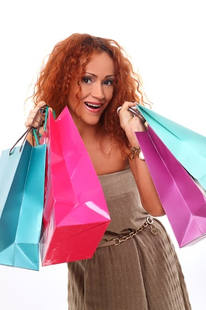 Beautiful redhead woman holding shopping bags photo