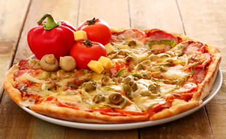 Fresh italian pizza in plate on a wooden surface Stock Photo - 17111386