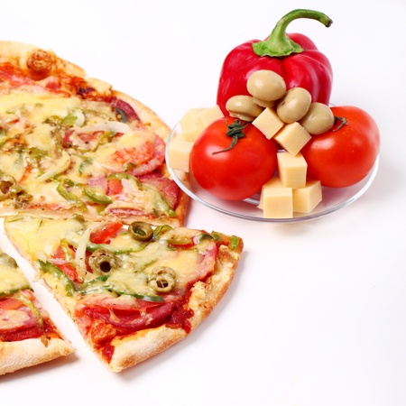 Image of sliced pizza and vegetables isolated over white background Stock Photo - 17110787