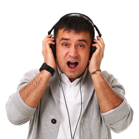 Young caucasian handsome man listening music isolated over white background Stock Photo - 17133263