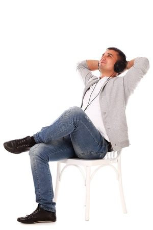 Young caucasian handsome man listening music isolated over white background Stock Photo - 17133258