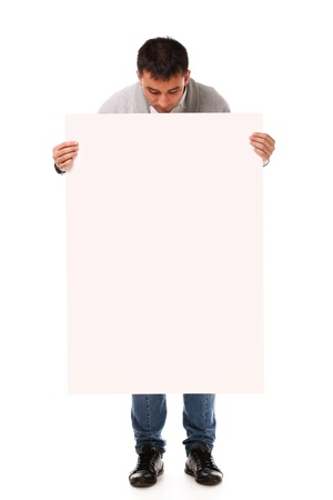 Young handsome man holding blank board ready for text on white background Stock Photo - 17093210