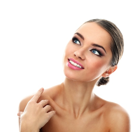 Young latino woman smiling isolated over white background photo