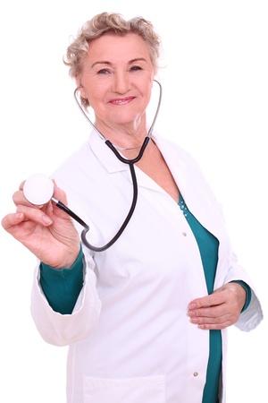 Happy old lady in doctor uniform isolated on whitebackground photo