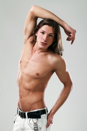brunets: Young sexy man with long hair isolated on white background