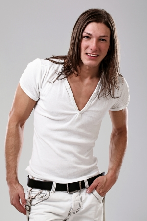 Young sexy man with long hair isolated on white background photo