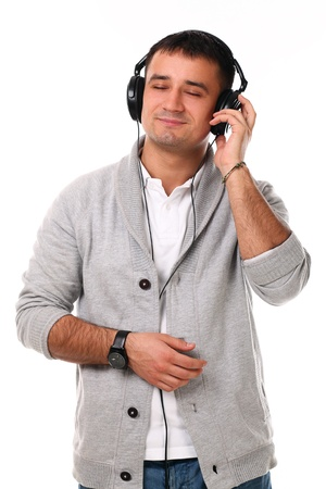 Young handsome man with headphones isolated over white background Stock Photo - 17489673