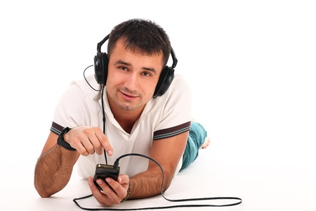 Young handsome man with headphones isolated over white background Stock Photo - 17489558