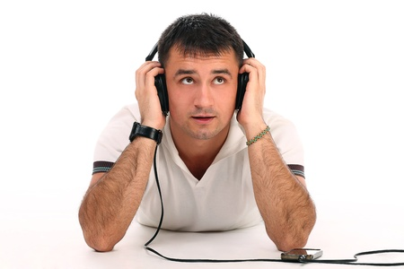 Young handsome man with headphones isolated over white background Stock Photo - 17489677