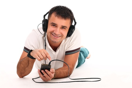 Young handsome man with headphones isolated over white background Stock Photo - 17489575