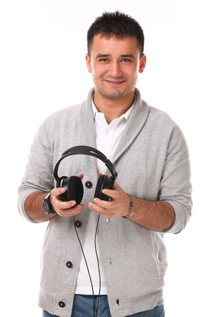 Young handsome man with headphones isolated over white background Stock Photo - 17489620